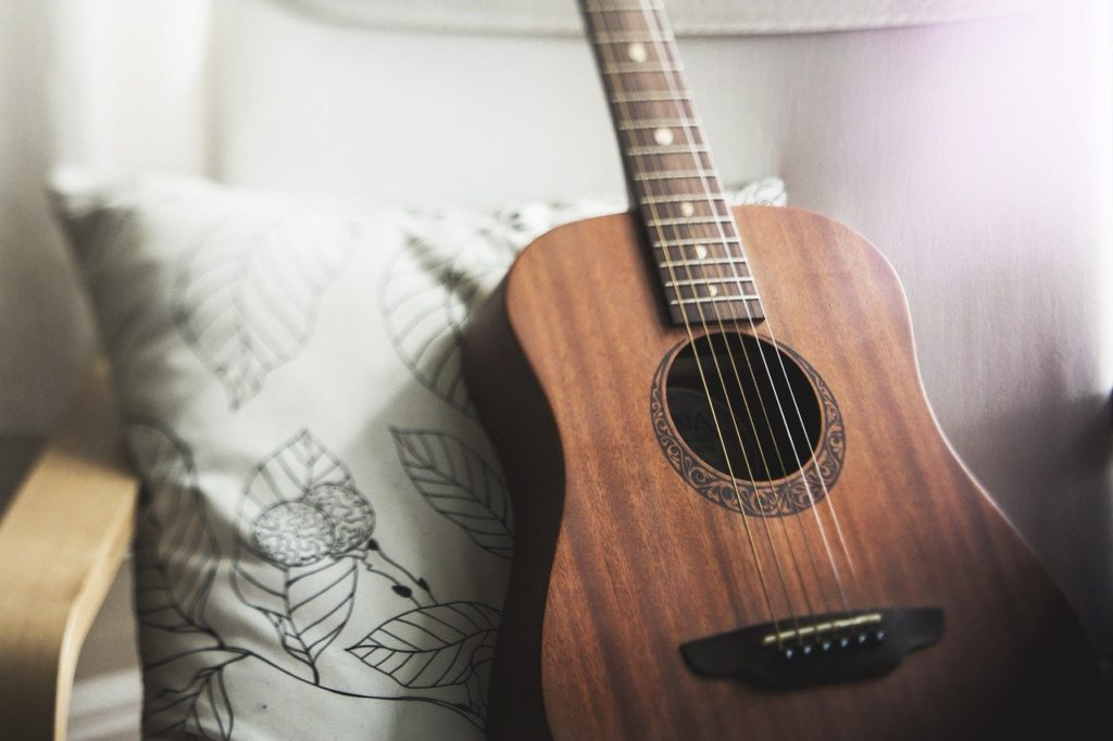 ter dom tocar violão